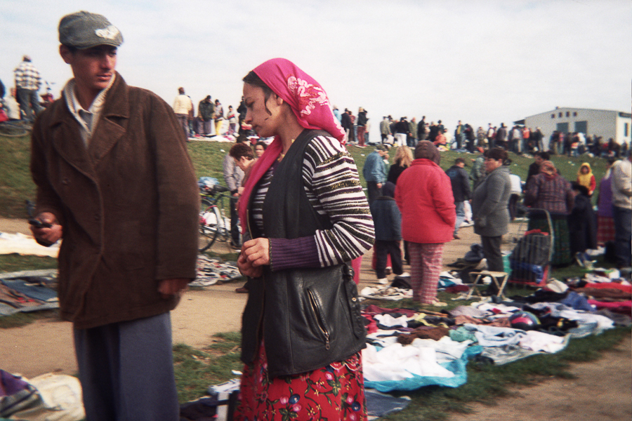 reading-an-sms-in-the-flea-market-of-targu-mures-2010